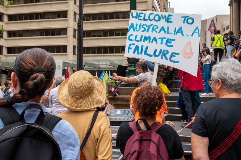 People with placards at a climate change protest at Sydney Town Hall. royalty free stock photography
