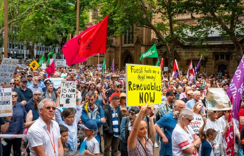 People with placards and flags at a climate change protest at Sydney Town Hall. royalty free stock images