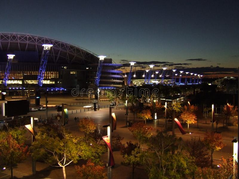 Sydney Olympic Park after dark. Sydney Olympic Park is home to sports stadiums and concert venues as well as restaurants, hotels and office buildings royalty free stock image