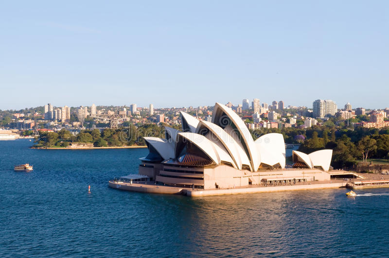 Sydney Opera House. World famous building Sydney Opera House in Australia with city skyline and Royal Botanic Gardens on the background of scenery. The Sydney royalty free stock photos