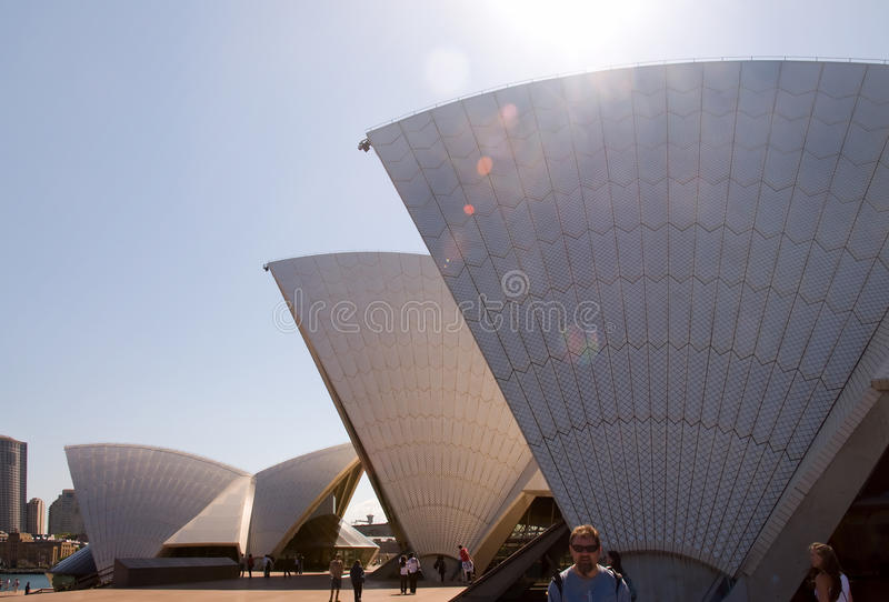 Sydney Opera House. World famous building Sydney Opera House with people/tourists in beam of sun rays from side view. Sydney, Australia The Sydney Opera House is royalty free stock photos