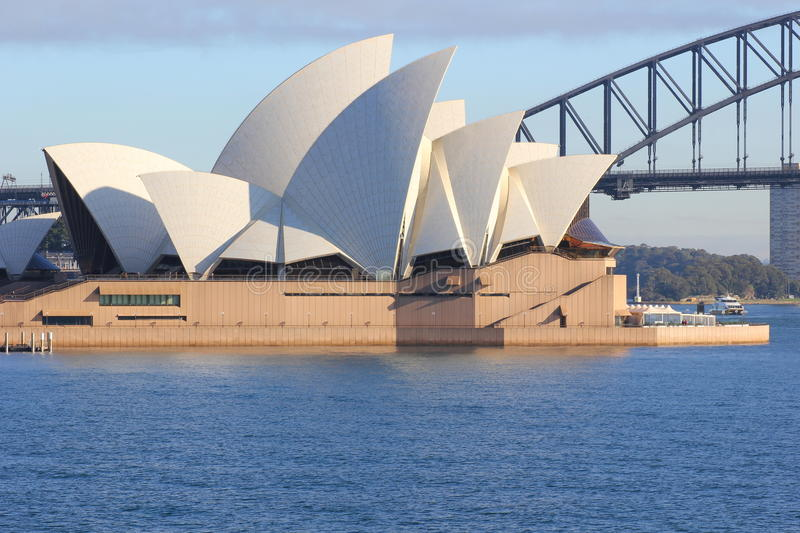 Sydney Opera House surrounded by blue water royalty free stock images