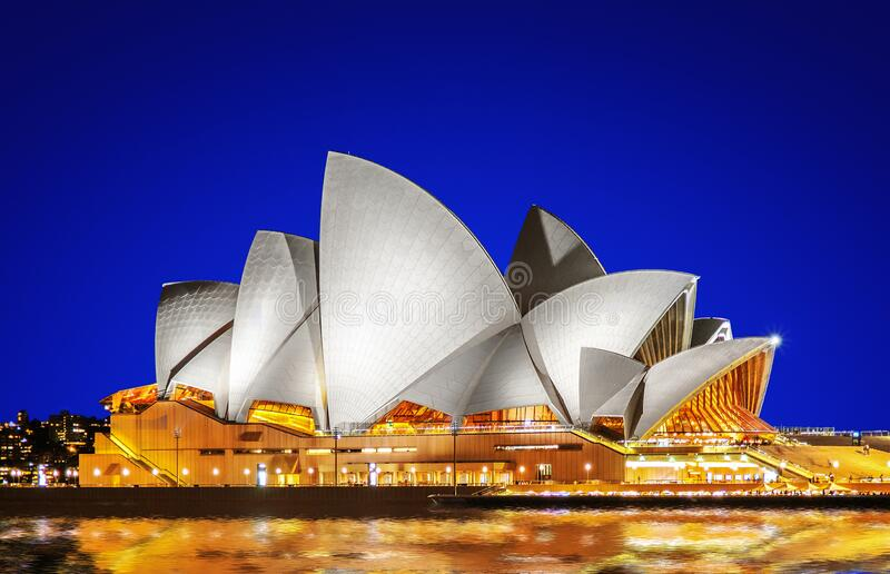 Sydney Opera House in the evening with clear blue sky stock image