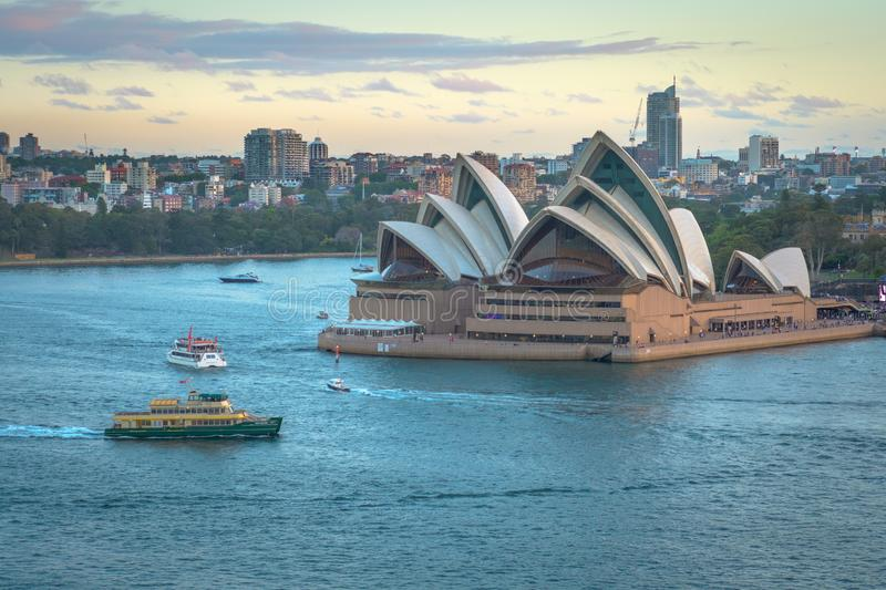The Sydney Opera House with ferries boats in the foreground, taken from the Harbor Bridge in Sydney, Australia stock photography