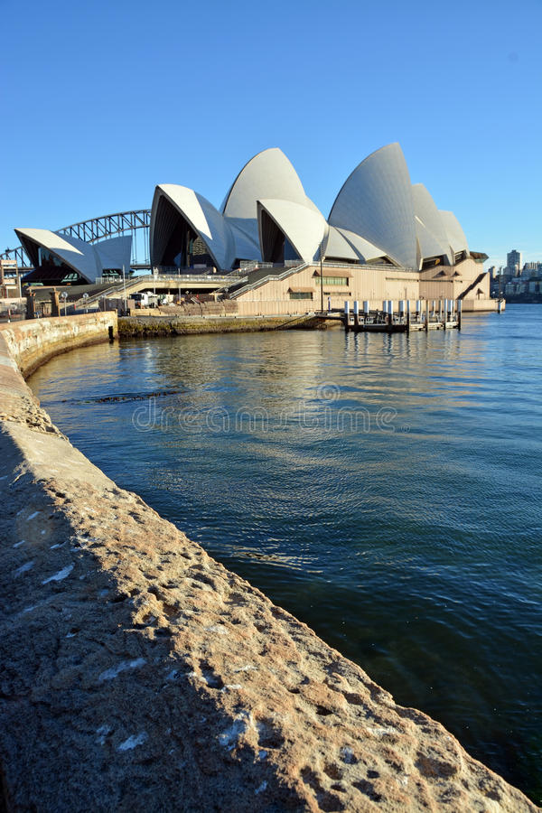 Sydney Opera House Vertical View with Wall in Foreground. stock photos
