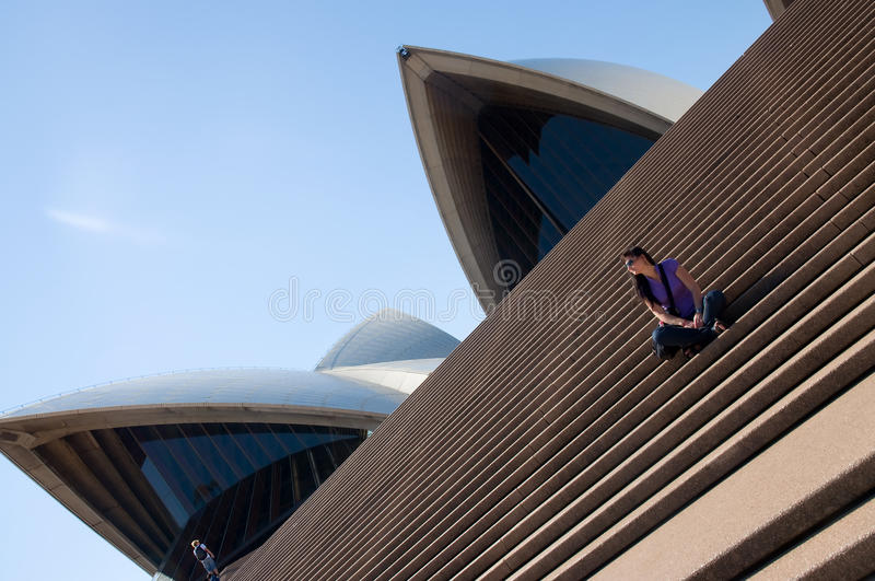 Sydney Opera House and young woman stock images
