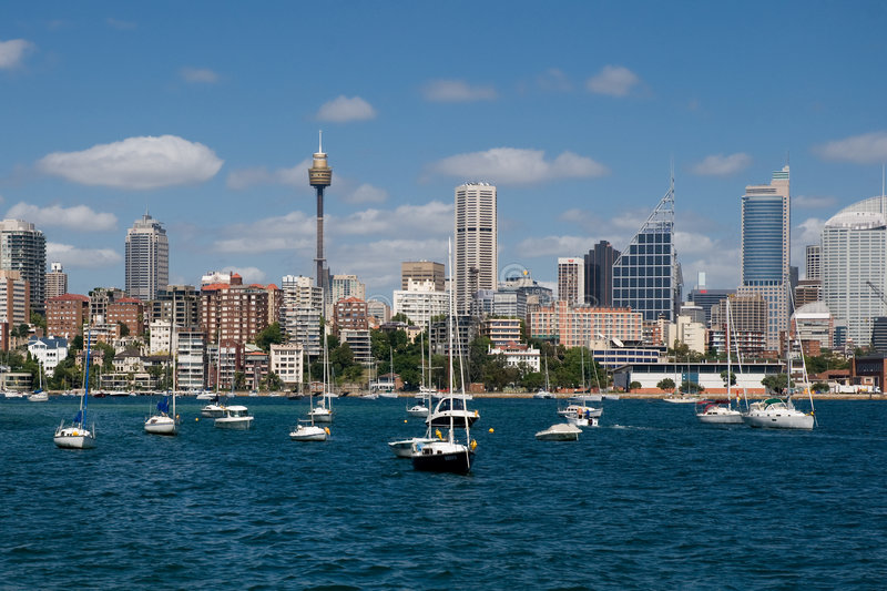 Sydney sky-scrapers. Australia, Sydney seafront with sky-scrapers, yachts and sunshine stock image