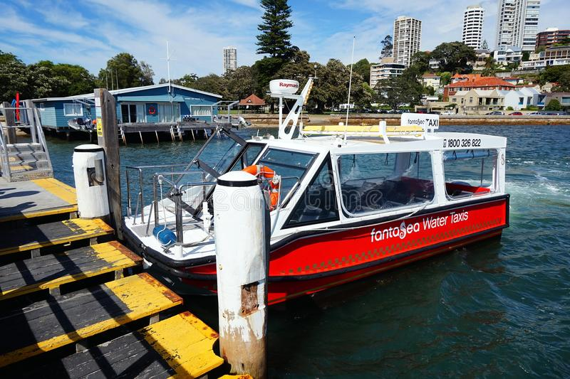 Sydney Water Taxi at Double Bay Wharf. A Sydney Harbour water taxi waiting for customers at Double bay wharf, Sydney, NSW, Australia stock photography