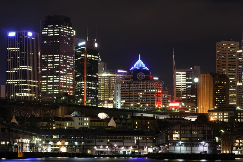 Metropolitan city with wharf and skyline by night stock photos
