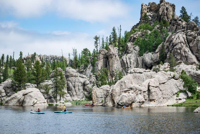 Sylvan Lake Kayakers imagem de stock royalty free