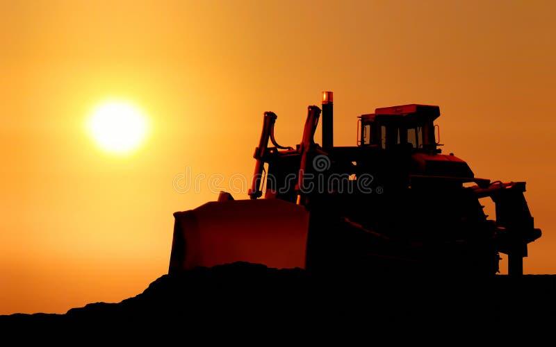 Sylwetka buldożer obrazy stock