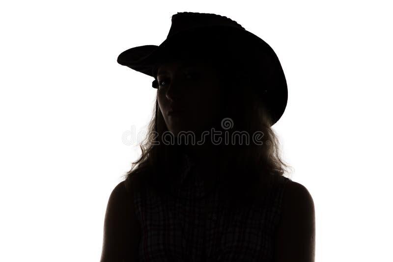 Sylwetka kobieta w kowbojskim kapeluszu obrazy royalty free