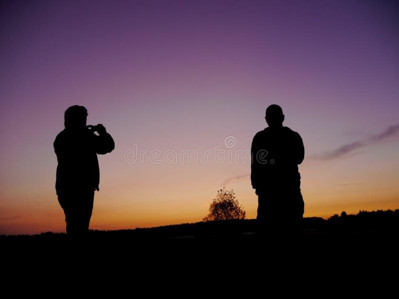 Sylwetka mężczyzna fotografować fotografia stock