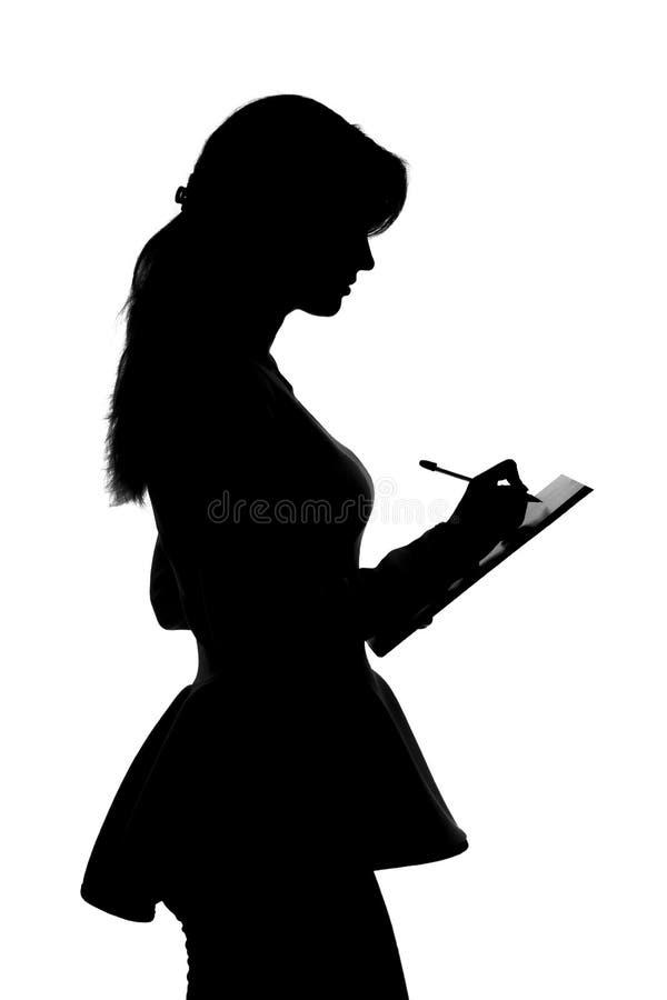 Sylwetka młody biznesowej kobiety podpisywania biznesu kontrakt fotografia royalty free