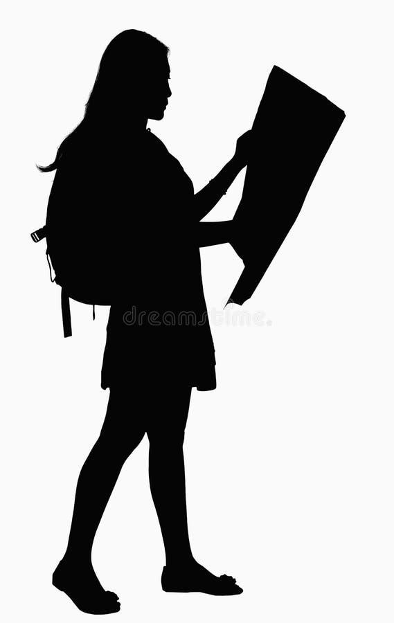 Sylwetka patrzeje mapę kobieta. zdjęcie royalty free