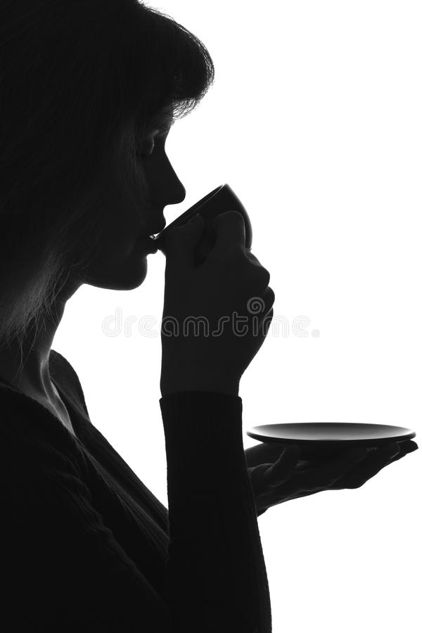 Sylwetka portret pije gorącą kawę kobieta obrazy royalty free
