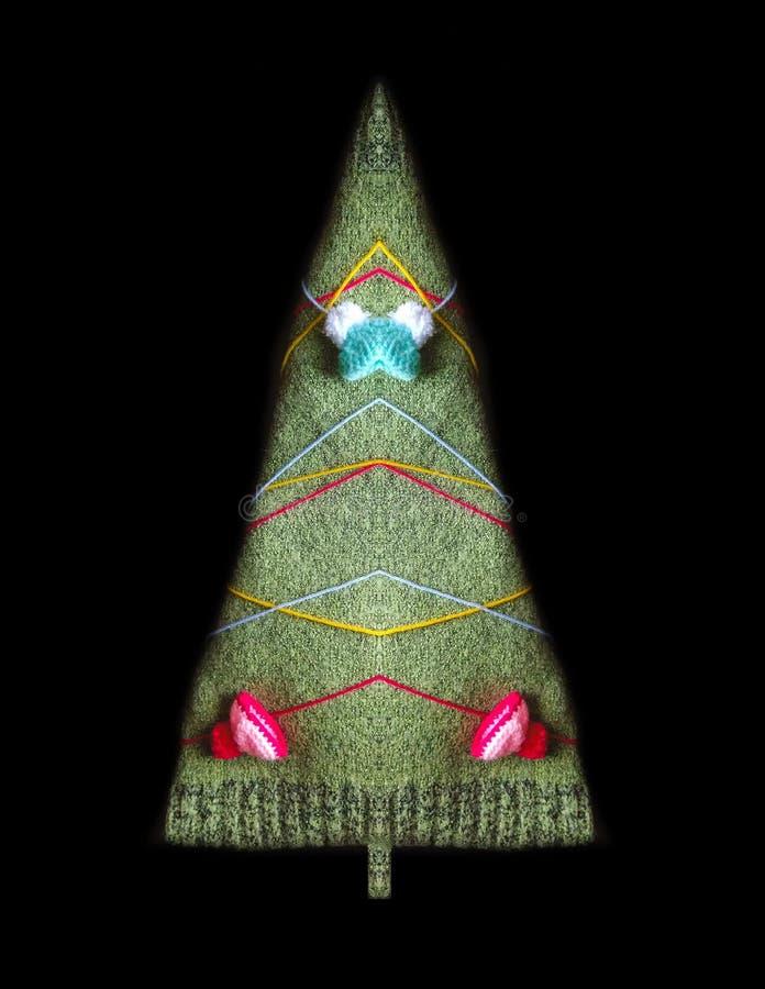 Sylwetka robić woolen płótno, kolorowe nici i dziający nakrętka wystrój jedlinowy drzewo, zdjęcie royalty free