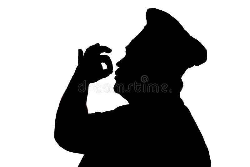 sylwetka szczęśliwy szef kuchni na białym odosobnionym tle, profil męska twarz w kucbarskim kapeluszu, karmowy pojęcie zdjęcia stock