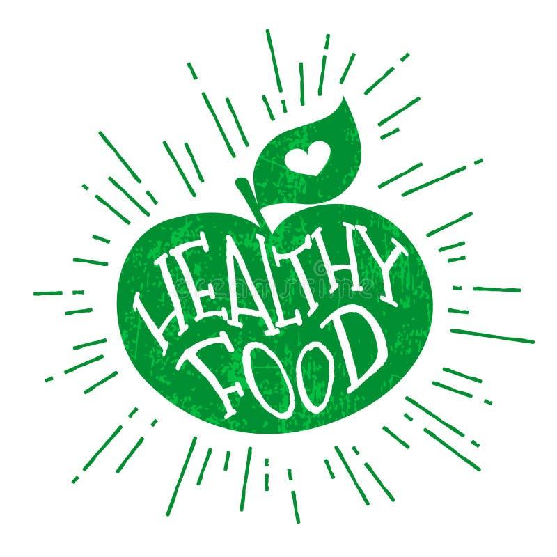 Sylwetka zielony jabłko z sercem i literowanie teksta Zdrowym jedzeniem Wektorowa kolor etykietka ilustracji