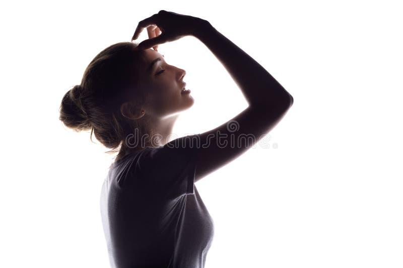 Sylwetka zmysłowa dziewczyna, kobiety twarzy profil na białym odosobnionym tle fotografia stock