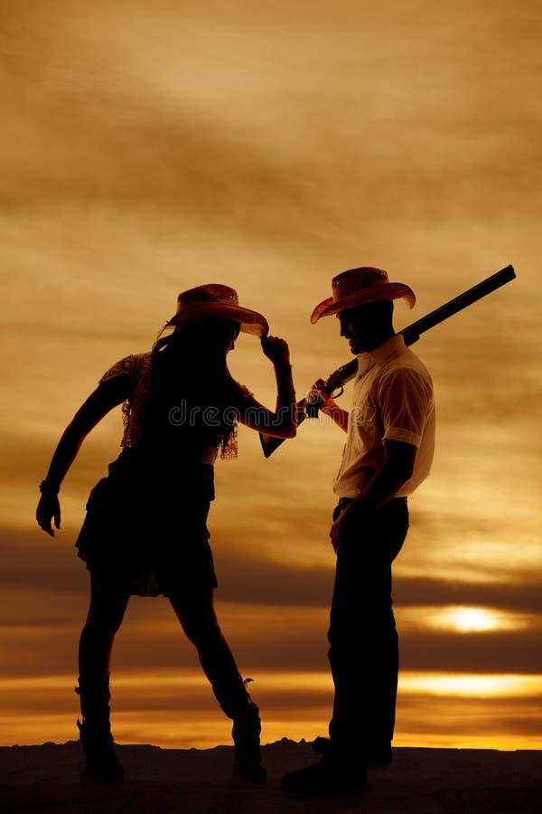 Sylwetki cowgirl pistoletu porady kowbojski kapelusz obraz royalty free