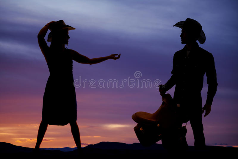 Sylwetki kobiety cowgirl ręka out obrazy royalty free