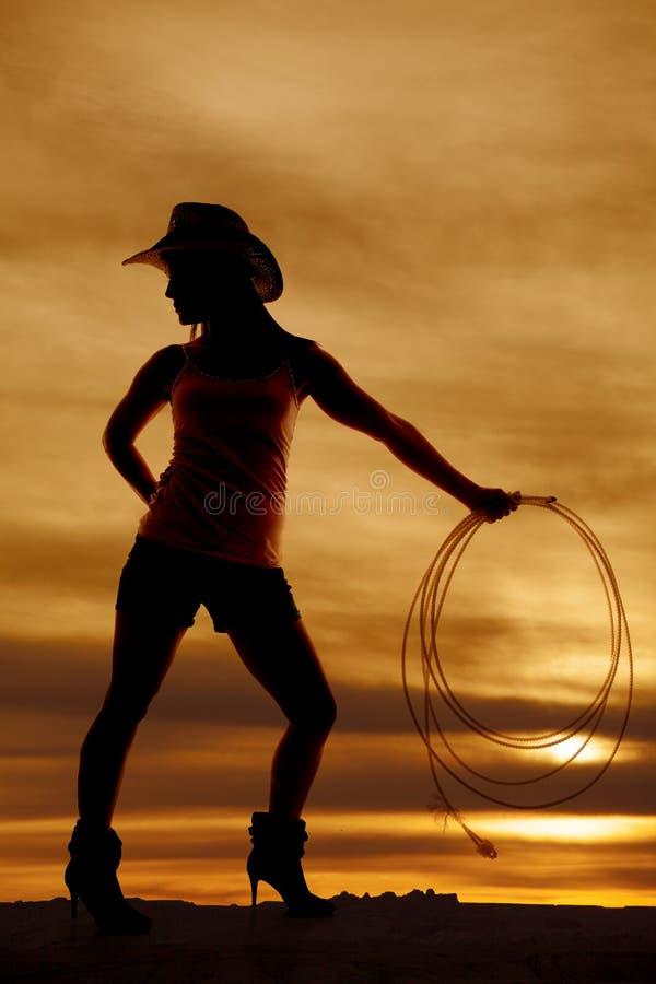 Sylwetki kobiety cowgirl spojrzenia z powrotem kapeluszowa arkana fotografia royalty free