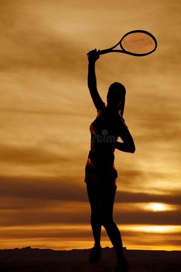 Sylwetki kobiety tenisowego racquet huśtawka obrazy royalty free