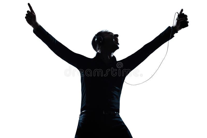 Sylwetki mężczyzna portreta szczęśliwy słuchanie muzyka obraz royalty free