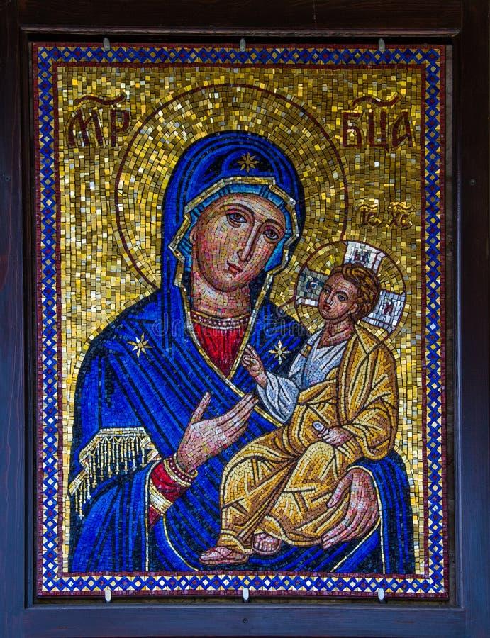 Symbol av oskulden Mary och Kristus arkivfoto