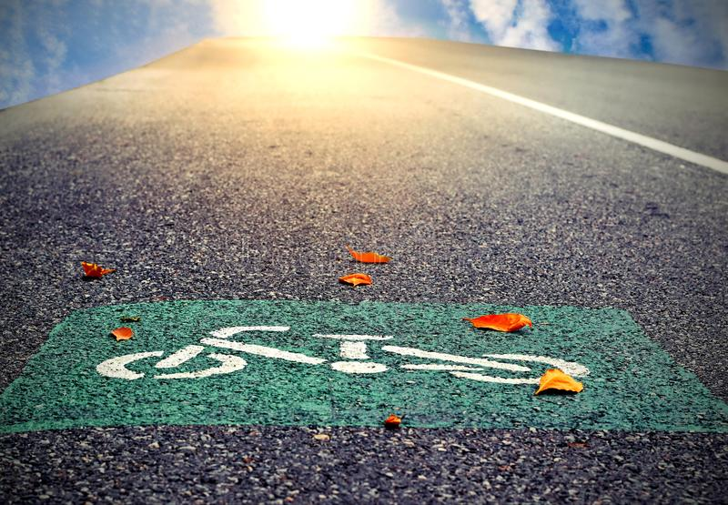 The symbol of the bike lane on the street. stock photography