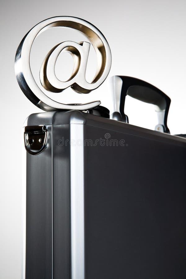 At symbol on briefcase