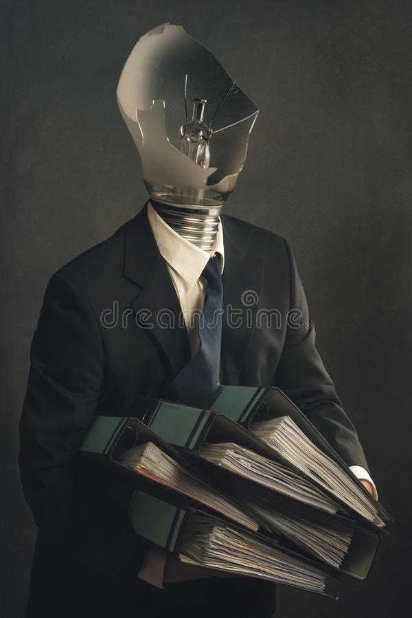 Symbol of a businessman with burnout syndrome royalty free stock image