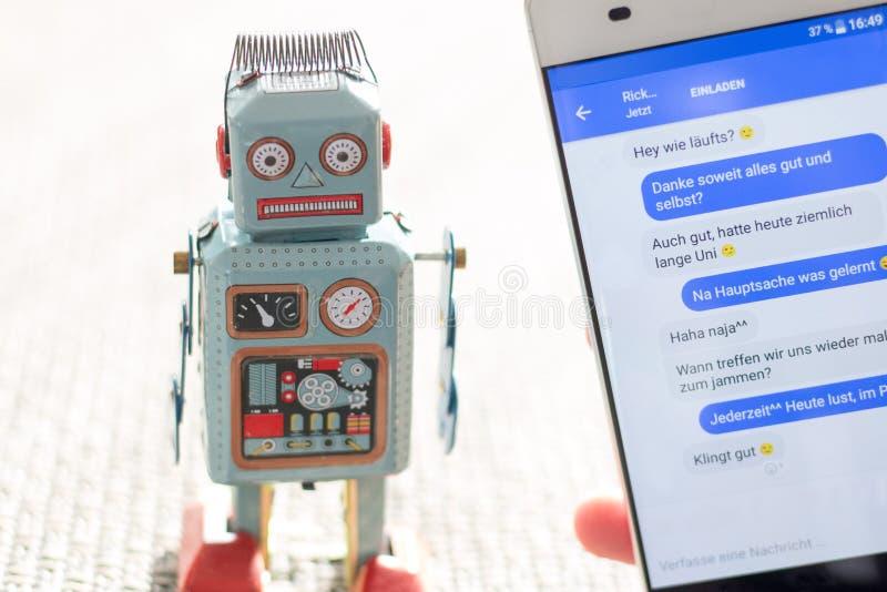 Symbol for chat bot, smartphone and messenger. Robot chatbot messenger surveillance social algorithm artificial code intelligence ai data big communication royalty free stock image