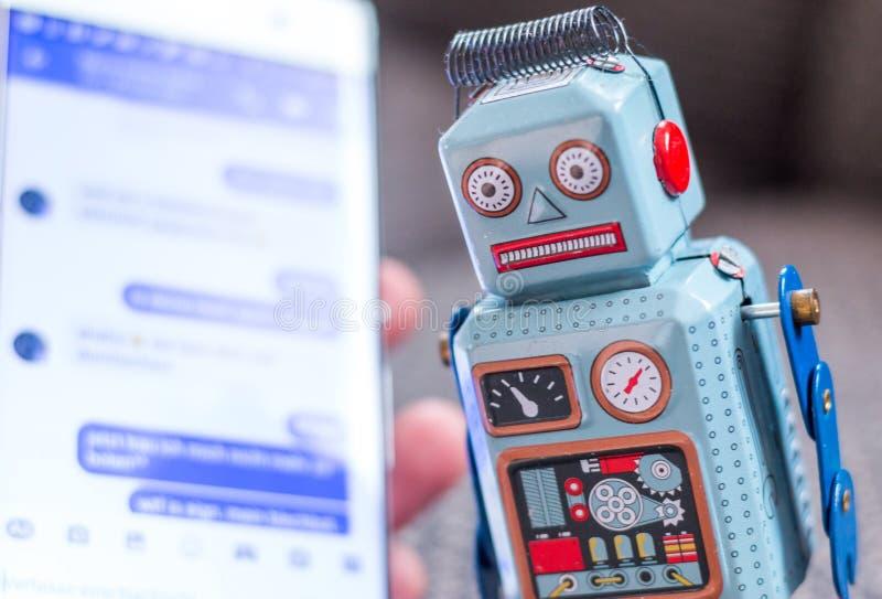 Symbol for chat bot, smartphone and messenger. Robot chatbot messenger surveillance social algorithm artificial code intelligence ai data big communication stock photos