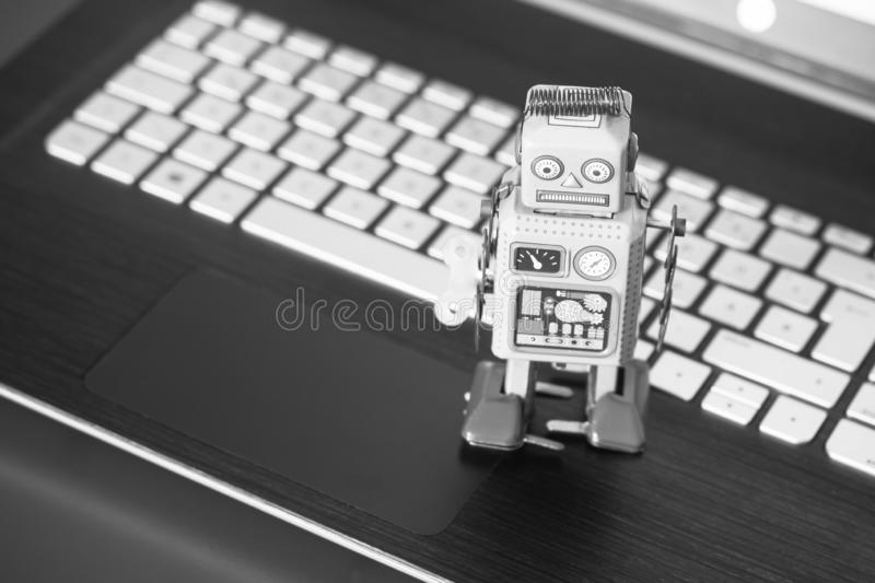 Symbol for a chat bot or social bot and algorithms, Laptop. Robot chatbot artificial intelligence ai data big computer future internet politics twitter royalty free stock photo
