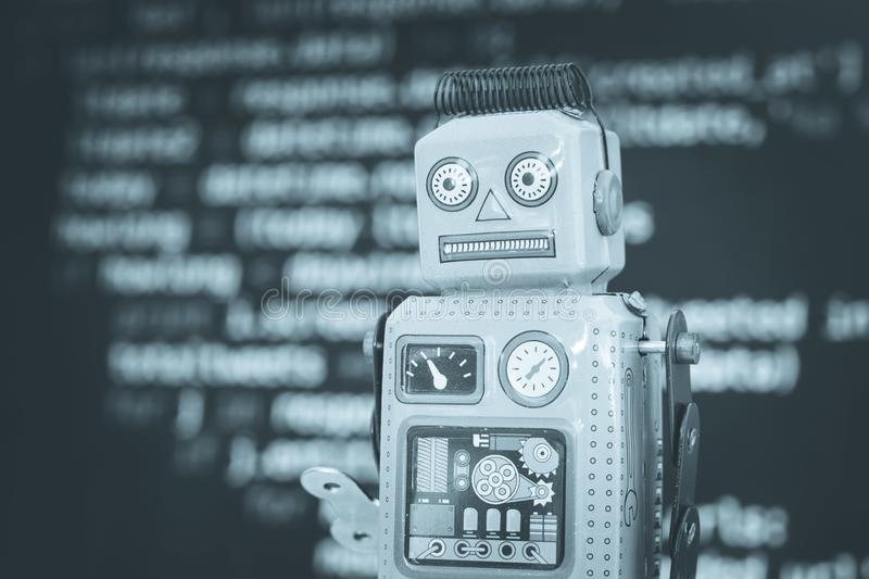 Symbol for a chatbot or social bot and algorithms, program code in the background. Robot artificial intelligence ai data big computer future internet politics royalty free stock images