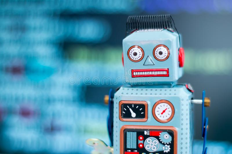 Symbol for a chatbot or social bot and algorithms, program code in the background. Robot artificial intelligence ai data big computer future internet politics royalty free stock photo
