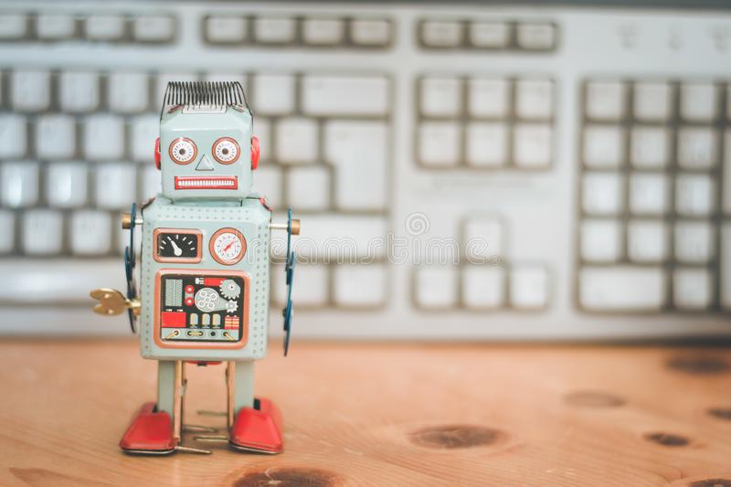 Symbol for a chatbot or social bot and algorithms, program code in the background. Robot artificial intelligence ai data big computer future internet politics royalty free stock image