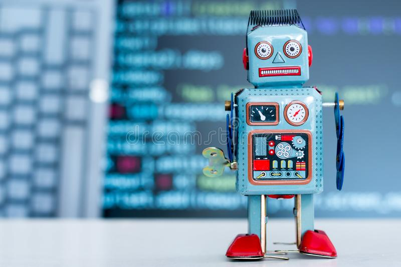 Symbol for a chatbot or social bot and algorithms, program code in the background. Robot artificial intelligence ai data big computer future internet politics royalty free stock photography