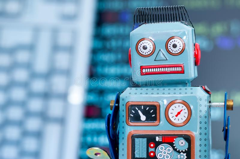Symbol for a chatbot or social bot and algorithms, program code in the background. Robot artificial intelligence ai data big computer future internet politics royalty free stock photos