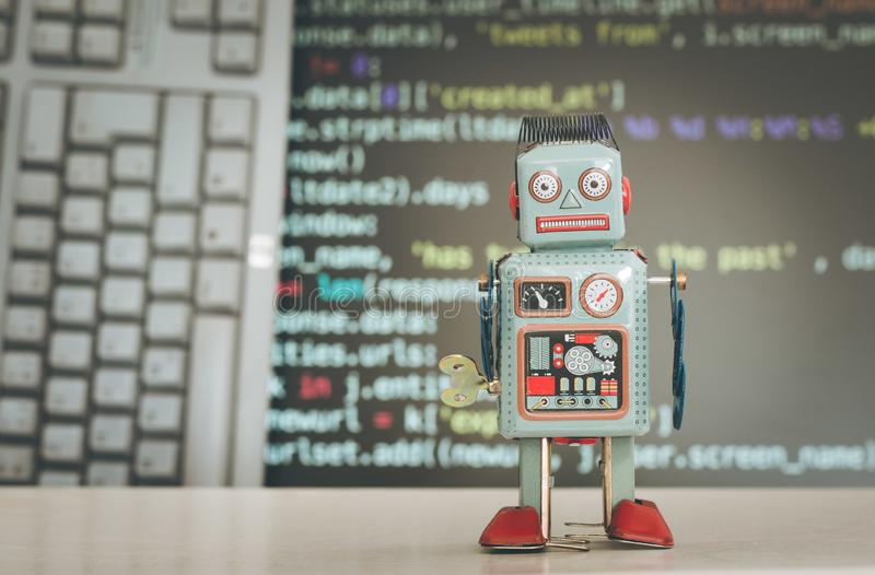 Symbol for a chatbot or social bot and algorithms, program code in the background. Robot artificial intelligence ai data big computer future internet politics stock photo