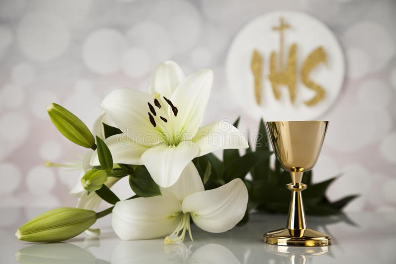 Symbol christianity religion a golden chalice with grapes and br. Holy communion a golden chalice with grapes and bread wafers royalty free stock photo
