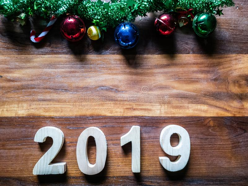 symbol Christmas Tree colorful, Is Number 2019 year on old wooden texture background Empty copy space for inscription design of h stock photos