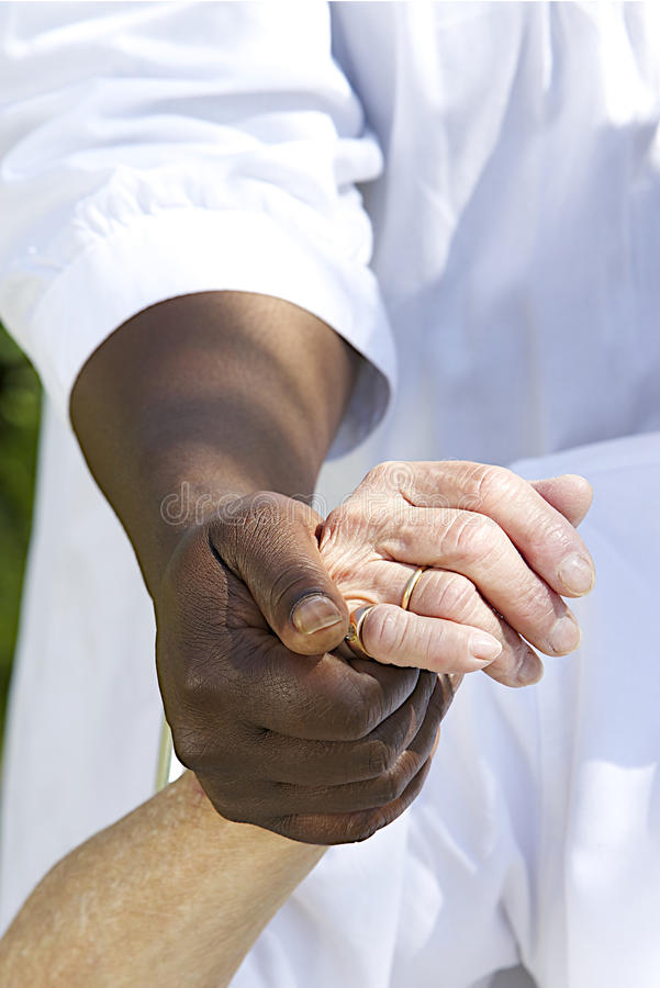 Symbol of comfort and support from a care giver to the Senior. Image Symbol of comfort and support from care giver to elderly woman outdoor holding her hand royalty free stock images