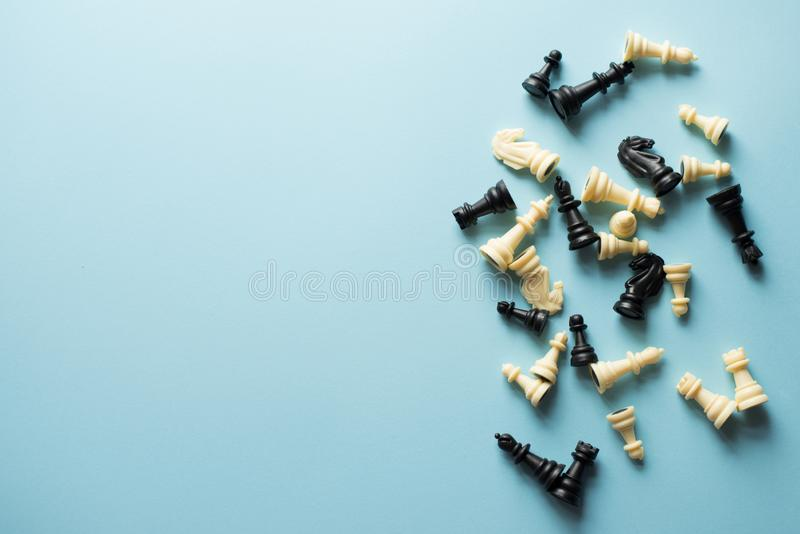 Symbol of competition. chess figures on blue background top view copy space.  stock images