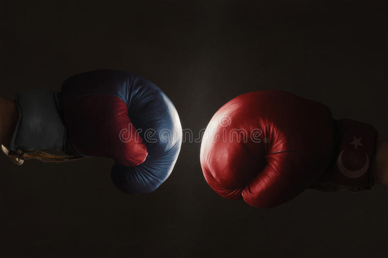 Symbol of the Crisis between Russia and Turkey symbolized with B. Symbol of the Crisis between Turkey and Russia symbolized with Boxing Gloves royalty free stock image