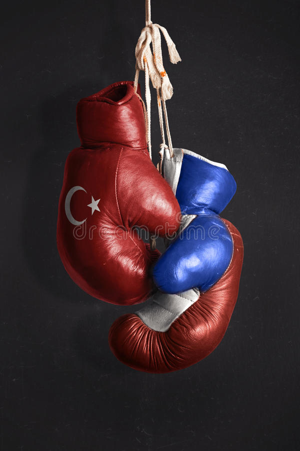 Symbol of the Crisis between Turkey and Russia. Symbolized with Boxing Gloves royalty free stock photography
