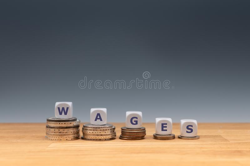Symbol for declining wages. stock image