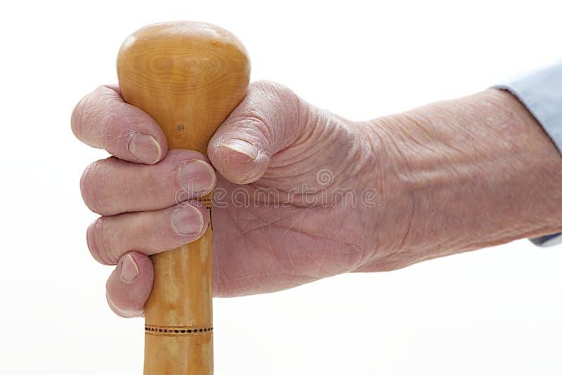 Symbol des hohen Alters, Hand, die einen Stock hält lizenzfreie stockfotografie